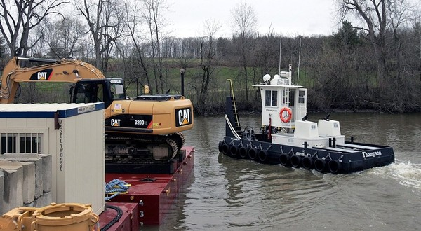 In this 2009 file photo, a tugboat working near a barge on the Champlain Canal at a General Electric treatment facility in Fort Edward at the beginning of the  Hudson River cleanup by General Electric