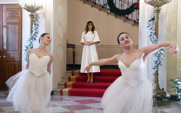 First Lady Melania Trump watches members of the Vivid Ballet company perform at the White House in Washington, DC, on Nov. 27, 2017. Ballerina Angela Mia Belmonte (right) hails from Clinton, N.Y.