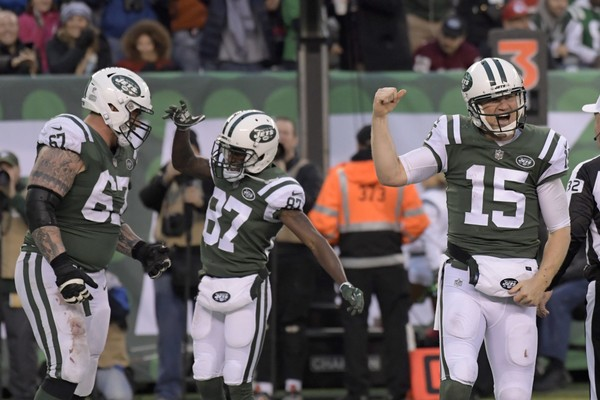 New York Jets quarterback Josh McCown, right, reacts after scoring a touchdown during the second half of an NFL football game against the Kansas City Chiefs, Sunday, Dec. 3, 2017, in East Rutherford, N.J. (AP Photo/Bill Kostroun)