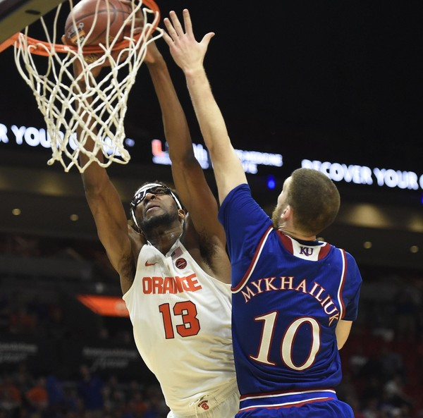 Syracuse center Paschal Chukwu (13) Kansas guard Sviatoslav Mykhailiuk (10) during a game  on Saturday, Dec. 2, 2017, in the Hoophall Miami Invitational at American Airlines Arena in Miami.Dennis Nett | dnett@syracuse.com