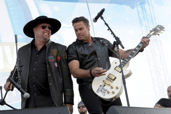 Eddie Montgomery and Troy Gentry of Montgomery Gentry perform at the Riverfront Stage during the 2012 CMA Music Festival on June 7, 2012, in Nashville, Tenn.