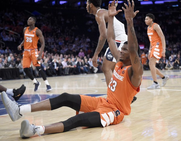 Syracuse guard Frank Howard looks for a foul during the Orange's win over Connecticut on Tuesday at Madison Square Garden. Howard was charged with nine turnovers in the game.
