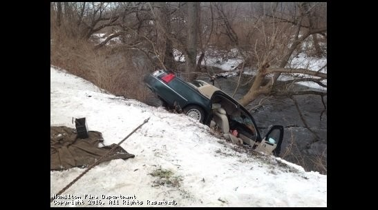 A car got stuck on a tree, hanging precariously over an 8-foot-high river embankment in Madison County after sliding off the road. Authorities had to rescue the trapped driver in December 2016. The Earlville and Hamilton fire departments were honored by the American Red Cross this morning.