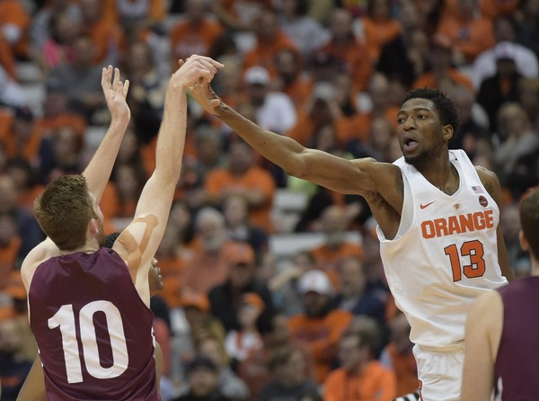 Syracuse's Paschal Chukwu defends Colgate's Will Rayman during the Orange's game against the Raiders last season.