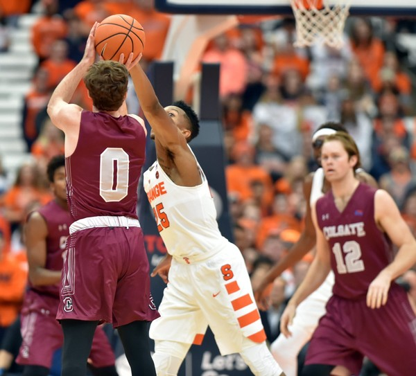 Colgate guard Sean O'Brien shoots a 3-pointer over Syracuse's Tyus Battle during Saturday's game at the Carrier Dome.