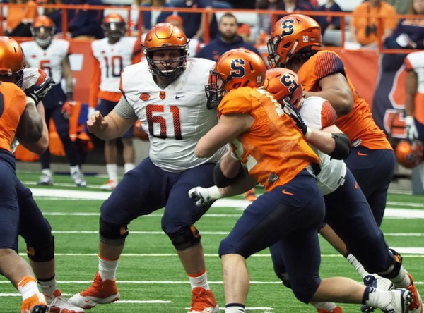 Syracuse offensive lineman Sam Clausman (61) announced his football career is over because of concussions.