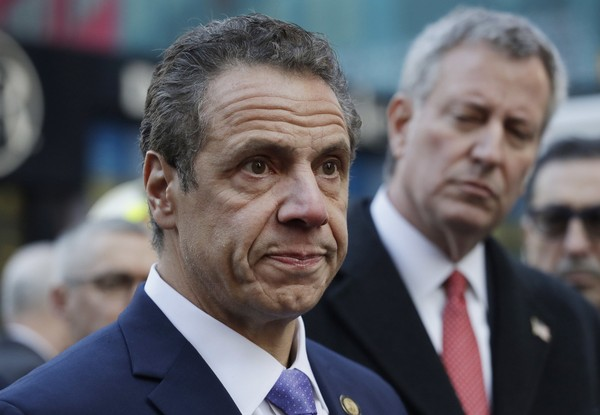 New York Gov. Andrew Cuomo, left, and Mayor Bill de Blasio attend a news conference, Monday, Dec. 11, 2017, outside the Port Authority Bus Terminal in New York after a pipe bomb strapped to a man went off in the subway near Times Square. (AP Photo/Mark Lennihan)