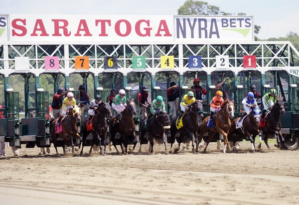 The horses break from the starting gate during the first race on opening day of the season at Saratoga Race Course in Saratoga Springs, N.Y., Friday, July 22, 2016.