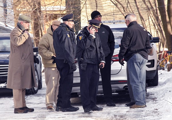 Troy police investigate multiple deaths at 158 Second Ave. on Tuesday, Dec. 26, 2017, in Troy, N.Y. Police say four people have been found dead and may have been killed in an apartment