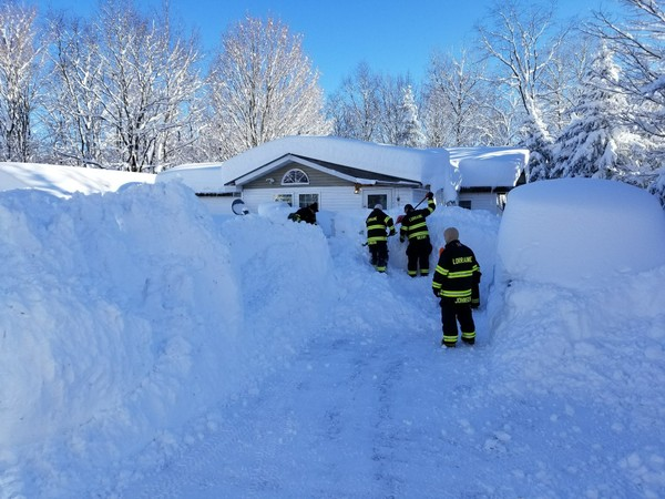 Firefighters in Lorraine, New York, were called to help a woman escape her home on French Settlement Road. More than six feet of snow fell in the area yesterday.