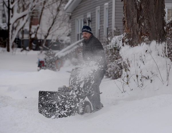 Sidney Wheeler Jr. clears snow from his driveway in early December, when the Watertown area was hit with a blast of winter weather.