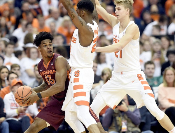 Syracuse's swarming defense held Virginia Tech to a season-low 56 points in a 12-point win over the Hokies at the Carrier Dome on Sunday.