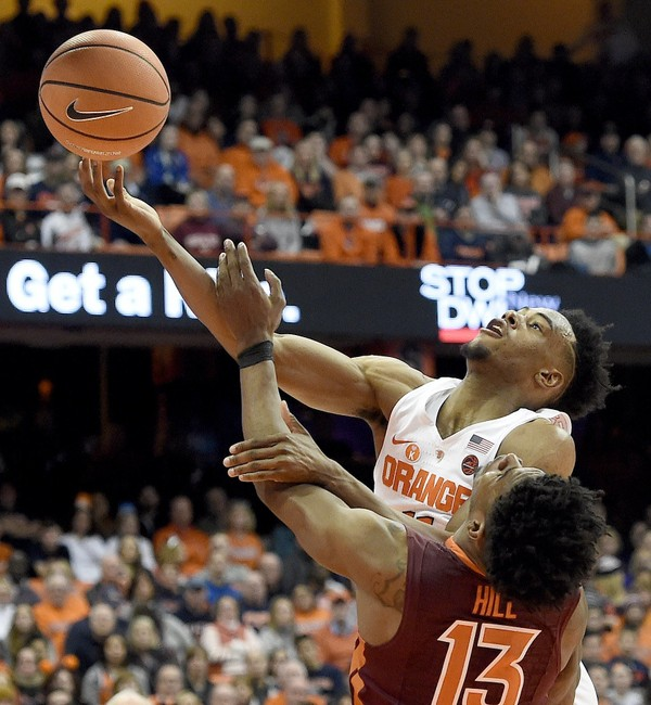 Syracuse forward Oshae Brissett (11) is fouled during a game against Virginia Tech on Sunday, Dec. 31, 2017, at the Carrier Dome. Dennis Nett | dnett@syracuse.com