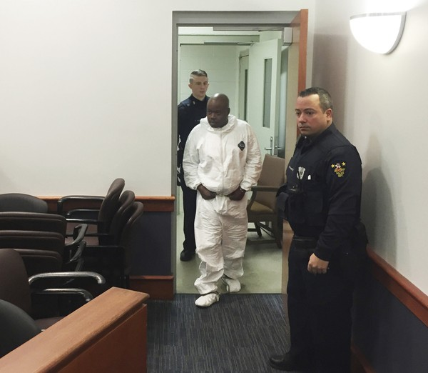 James White, left, enters the court room for arraignment on murder charges, Saturday, Dec. 30, 2017, in Troy, N.Y. He is one of two men arrested in connection with the deaths of two women and two children in their upstate New York apartment.