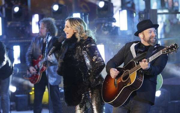 Jennifer Nettles, left, and Kristian Bush of Sugarland, perform on stage at the New Year's Eve celebration in Times Square on Sunday, Dec. 31, 2017, in New York.