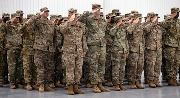 Soldiers from the Army's 10th Mountain Division, Combat Aviation Brigade, salute after returning from nine months deployed to Europe. The 104 soldiers were greeted by family and friends at Wheeler Sack Army Airfield at Fort Drum, October 18, 2017.  Michael Greenlar | mgreenlar@syracuse.com