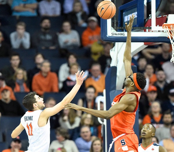 Virginia guard Ty Jerome (11) shoots a floater over Syracuse center Paschal Chukwu (13) during a game on Tuesday, Jan. 9, 2018, at John Paul Jones Arena in Charlottesville, Va.