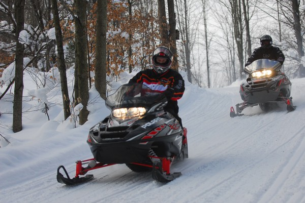 Adam Myers,Baldwinsville, front, and Darl Johnston, Cicero, take to the trails on their snow mobiles near the Grist Mill restaurant in  Parish, NY.
