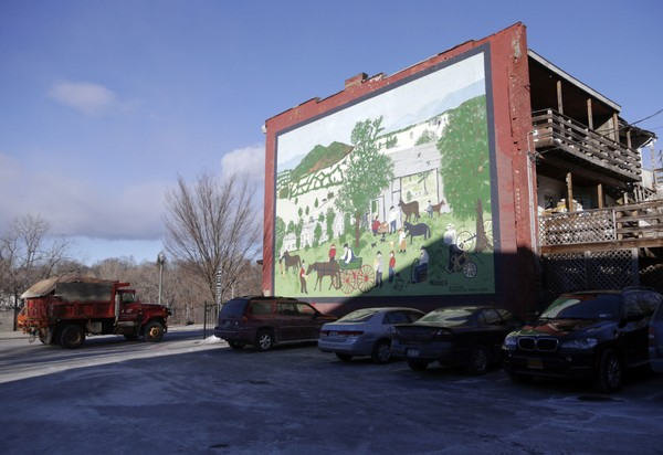 In this Jan. 21, 2016 photo, a mural of a Grandma Moses painting adorns a building in Hoosick Falls, N.Y.