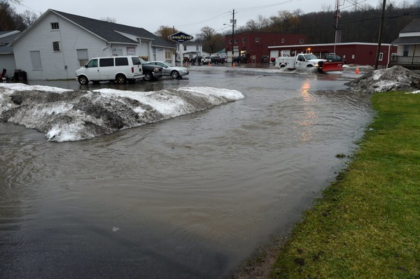 Over a 2-hour period, a stretch of homes and the Port Byron Fire Department were flooded along Route 31 Friday, Jan. 12, 2018, as water from the Erie Canal rose up over the banks. Water quickly spread to the parking lots and businesses across the street. Lauren Long | llong@syracuse.com