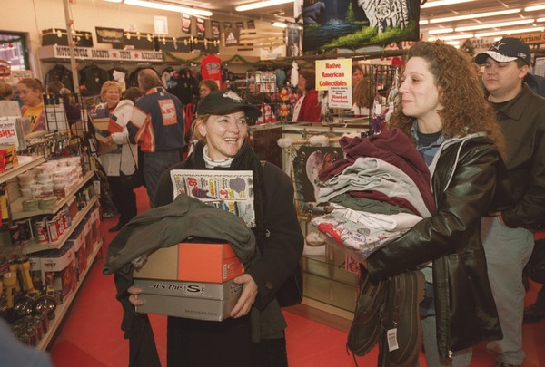 """Sharon Wilsey of Pennsylvania and sister Sandy Wilsey of Canastota take advantage of post-Thanksgiving sale at """"Herb"""" Philipson's store in Oneida in 2002. The store's president, Gary Philipson, announced Monday that the store would be put up for sale."""