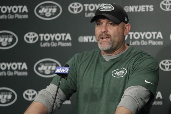 In this Tuesday, May 23, 2017 photo, New York Jets offensive coordinator John Morton talks to reporters during the team's organized team activities at its NFL football training facility in Florham Park, N.J. A person with direct knowledge of the decision says the New York Jets have fired offensive coordinator John Morton after one season. The person spoke to The Associated Press on Wednesday, Jan. 17, 2018 on condition of anonymity because the team had not announced the move.(AP Photo/Julio Cortez, File)