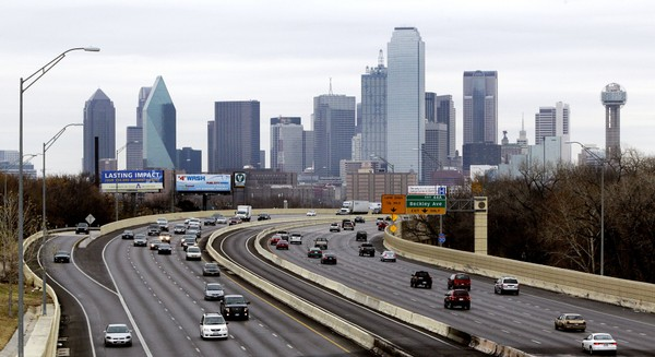 This Friday, Jan. 14, 2011, file photo shows highway IH-30 traffic with the Dallas skyline in the background. Dallas is one of 20 cities named finalists for Amazon's second headquarters.