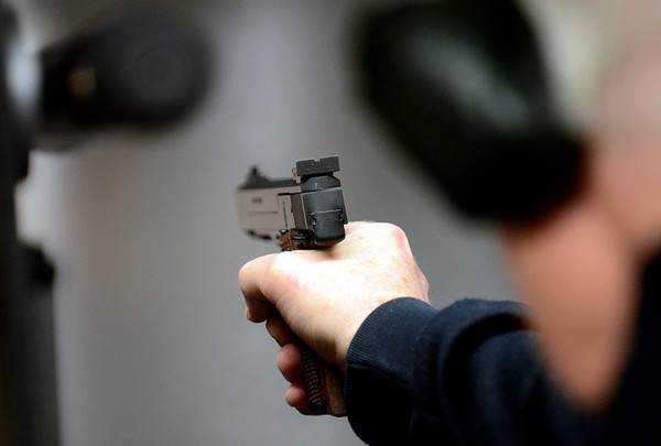 A shooter competes in January 2012 at the Syracuse Pistol Club in Clay. ( Stephen D. Cannerelli / The Post-Standard | File photo, 2012)