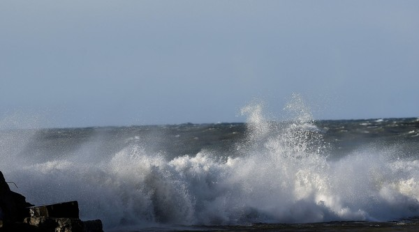 High winds creates big waves along the break wall near the lighthouse on Ontario Lake in Oswego.