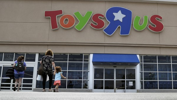 In this Tuesday, Sept. 19, 2017, file photo, shoppers walk into a Toys R Us store, in San Antonio.