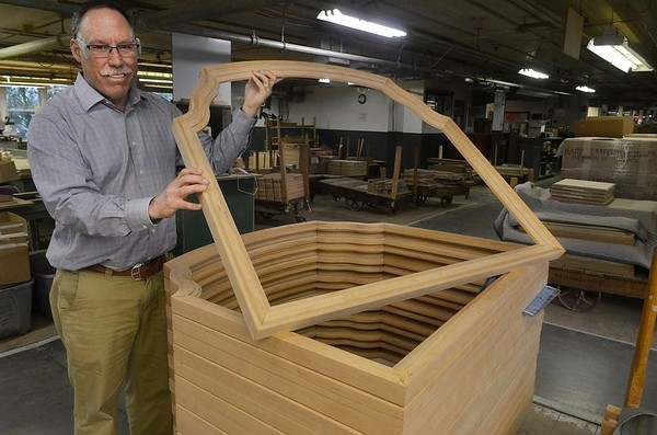 Greg Harden, CEO of Harden Furniture, shows a mirror frame manufactured at the company's factory in the Oneida County hamlet of McConnellsville in March 2016.