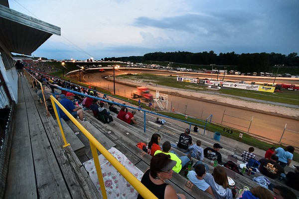 The race fans at the Fulton Speedway wait for the feature races to begin as the clay track is resurfaced. Ellen M. Blalock | eblalock@syracuse.com