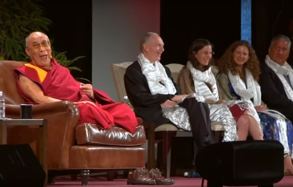 His Holiness the Dalai Lama, left, is pictured on stage at an NXIVM event in Albany on May 6, 2009. Second from right is Sara Bronfman, an NXIVM member who reportedly helped book the Tibetan spiritual leader with a $1 million fee.