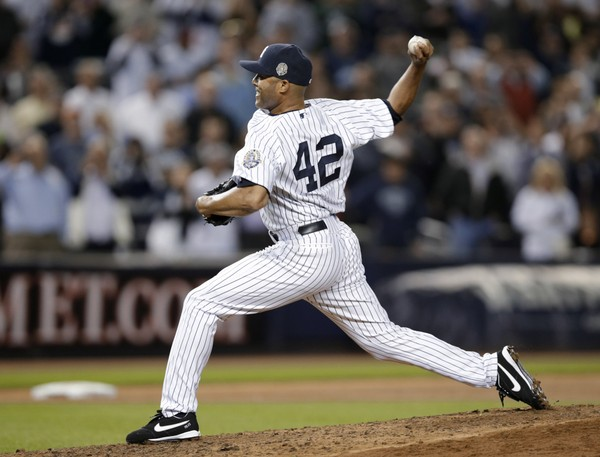 New York Yankees relief pitcher Mariano Rivera (42) delivers against the Tampa Bay Rays in the eighth inning of his final appearance in a baseball game at Yankee Stadium, Thursday, Sept. 26, 2013, in New York.
