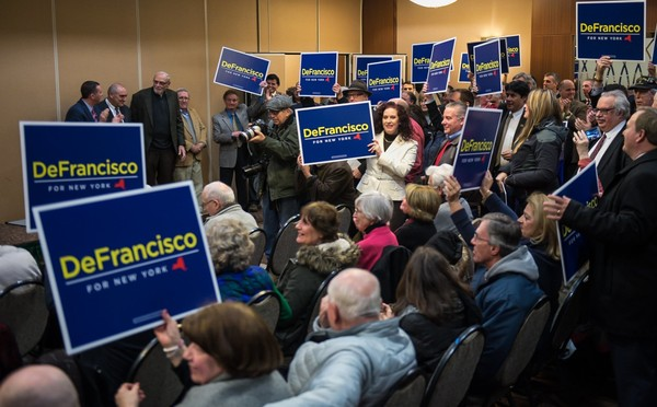 Supporters for State Sen. John DeFrancisco cheer him into the room at the Holiday Inn in Liverpool where he formally announced his run for governor of New York as a Republican, Tuesday, Jan. 30, 2018.