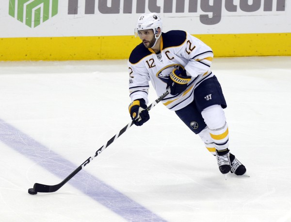 This March 28, 2017, file photo shows Buffalo Sabres forward Brian Gionta carrying the puck against the Columbus Blue Jackets during an NHL hockey game in Columbus, Ohio.