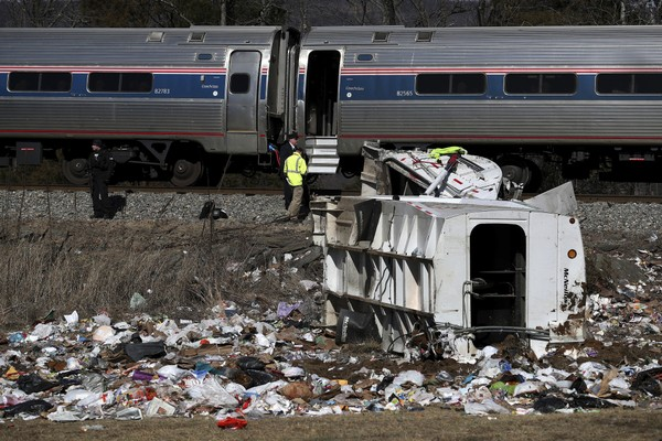 Emergency personnel work at the scene of a train crash involving a garbage truck in Crozet, Va., on Wednesday, Jan. 31, 2018. An Amtrak passenger train carrying dozens of GOP lawmakers to a retreat in West Virginia struck a garbage truck south of Charlottesville, Va.  (Zack Wajsgrasu/The Daily Progress via AP)