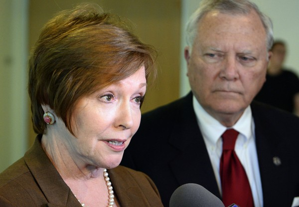 In this Oct. 16, 2014 file photo, Brenda Fitzgerald, Georgia Department of Public Health commissioner, left, and Georgia Gov. Nathan Deal respond to questions in Atlanta.  U.S. officials announced that Fitzgerald, the director of the nation's top public health agency has resigned because of financial conflicts of interest.
