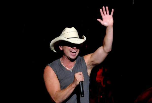 Kenny Chesney waves to his fans through the rain while performing at the New York State Fair Grandstand in 2009.