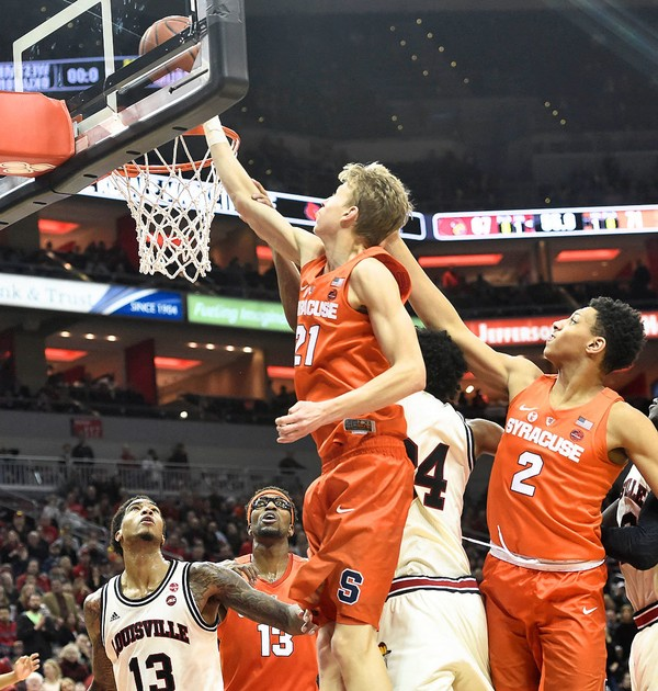 Syracuse forward Marek Dolezaj (21) tips the ball in the basket during a game against Louisville on Monday, Feb. 5, 2018, at the KFC Yum Center in Louisville, Ky.