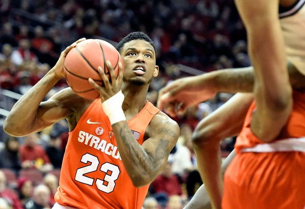 Syracuse guard Frank Howard (23) goes in for a layup during a game against Louisville on Monday, Feb. 5, 2018, at the KFC Yum Center in Louisville, Ky.
