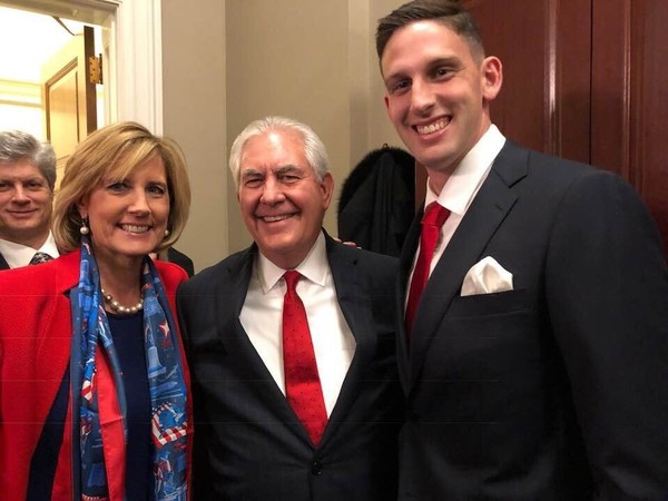Rep. Claudia Tenney poses for a photo with U.S. Secretary of State Rex Tillerson, center, and her son, Marine Capt. Trey Cleary, before President Donald Trump's first State of the Union address on Tuesday, Jan. 30, 2018, at the U.S. Capitol in Washington, D.C.