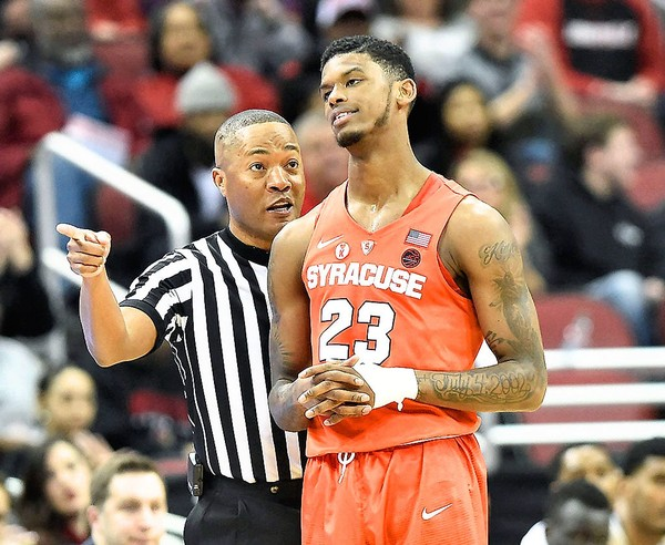 Syracuse guard Frank Howard (23) gets his fourth foul during a game against Louisville on Monday, Feb. 5, 2018, at the KFC Yum Center in Louisville, Ky.
