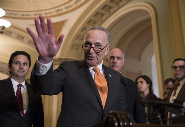 Senate Minority Leader Chuck Schumer, D-N.Y., flanked by Sen. Brian Schatz, D-Hawaii, left, and Sen. Bob Casey, D-Pa., speaks with reporters as work continues on a plan to keep the government open as a funding deadline approaches. (AP Photo/J. Scott Applewhite)