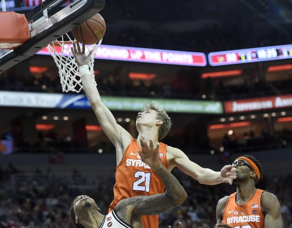 Syracuse's win over Louisville put the Orange right on the edge of the NCAA Tournament bubble, according to most projections.