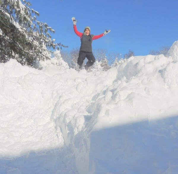 Caroyln Yerdon, the NWS observer in Redfield, climbed atop a 15-foot pile of snow in December. As of Feb. 9, Redfield has had 307 inches of snow this season. (Courtesy Carolyn Yerdon)