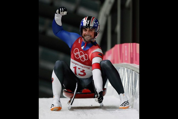 Chris Mazdzer of United States brakes in the finish area after the third run during final heats of the men's luge competition at the 2018 Winter Olympics in Pyeongchang, South Korea, Sunday, Feb. 11, 2018.
