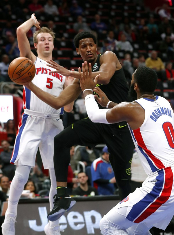 Atlanta Hawks' Andrew White III drives on Detroit Pistons center Andre Drummond (0) as Luke Kennard (5) defends in the first half of an NBA basketball game in Detroit, Wednesday, Feb. 14, 2018. (AP Photo/Paul Sancya)