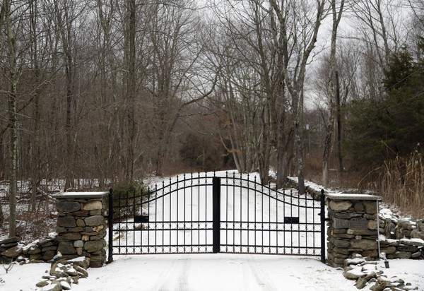 In this Feb. 1, 2018, photo, the gates of Leather Hill Preserve are viewed in Wingdale, N.Y. A company tied to Donald Trump Jr. and Eric Trump owns the 171-acre hunting preserve that is being used as a private shooting range.