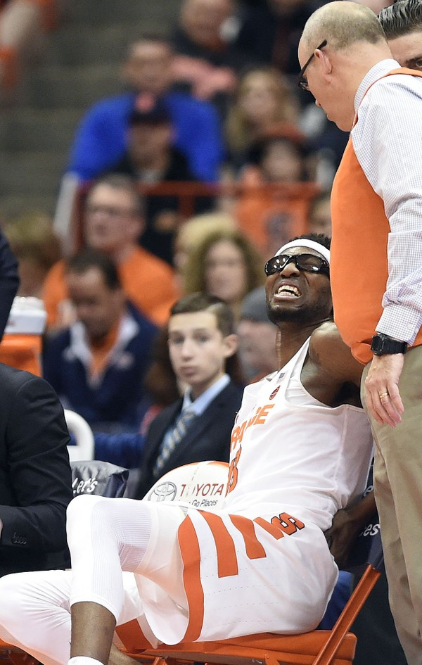 Syracuse center Paschal Chukwu grimaces on the bench after injuring his back in the Orange's loss to North Carolina State on Wednesday night.